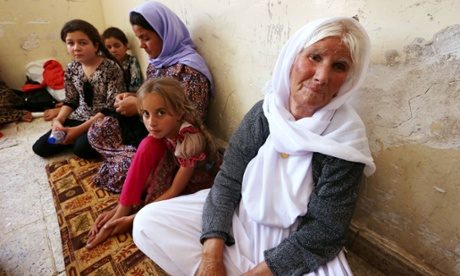 Yazidi women and girls from Sinjar province who fled ISIS violence an the threat of abduction (photo: Guardian)