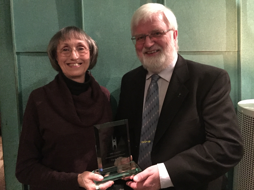Hope Knutsson receives the Distinguished Service to Humanism Award from Roar Johnsen