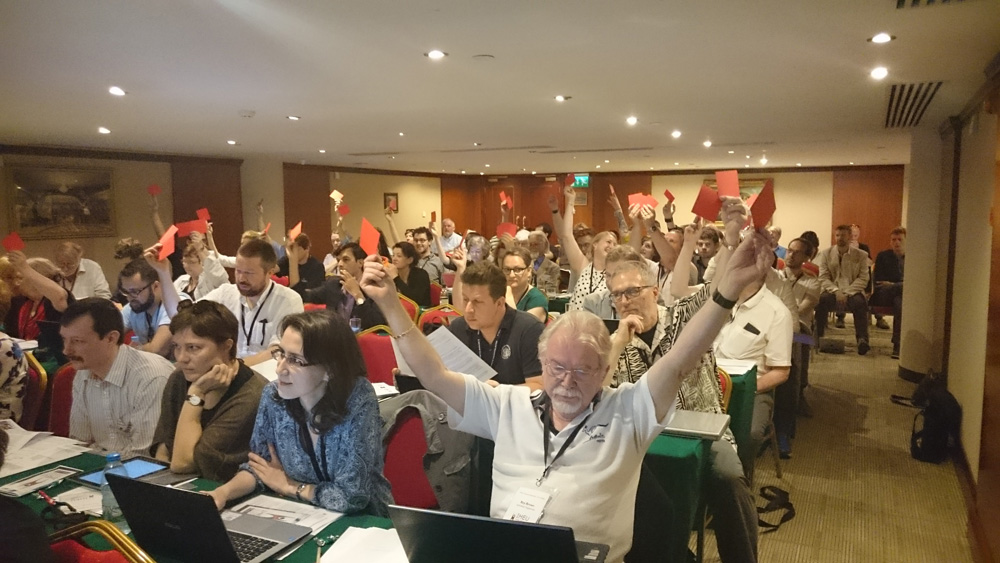 Voting delegates at the IHEU General Assembly 2016 approving new Member Organizations from countries including Iran and Pakistan.