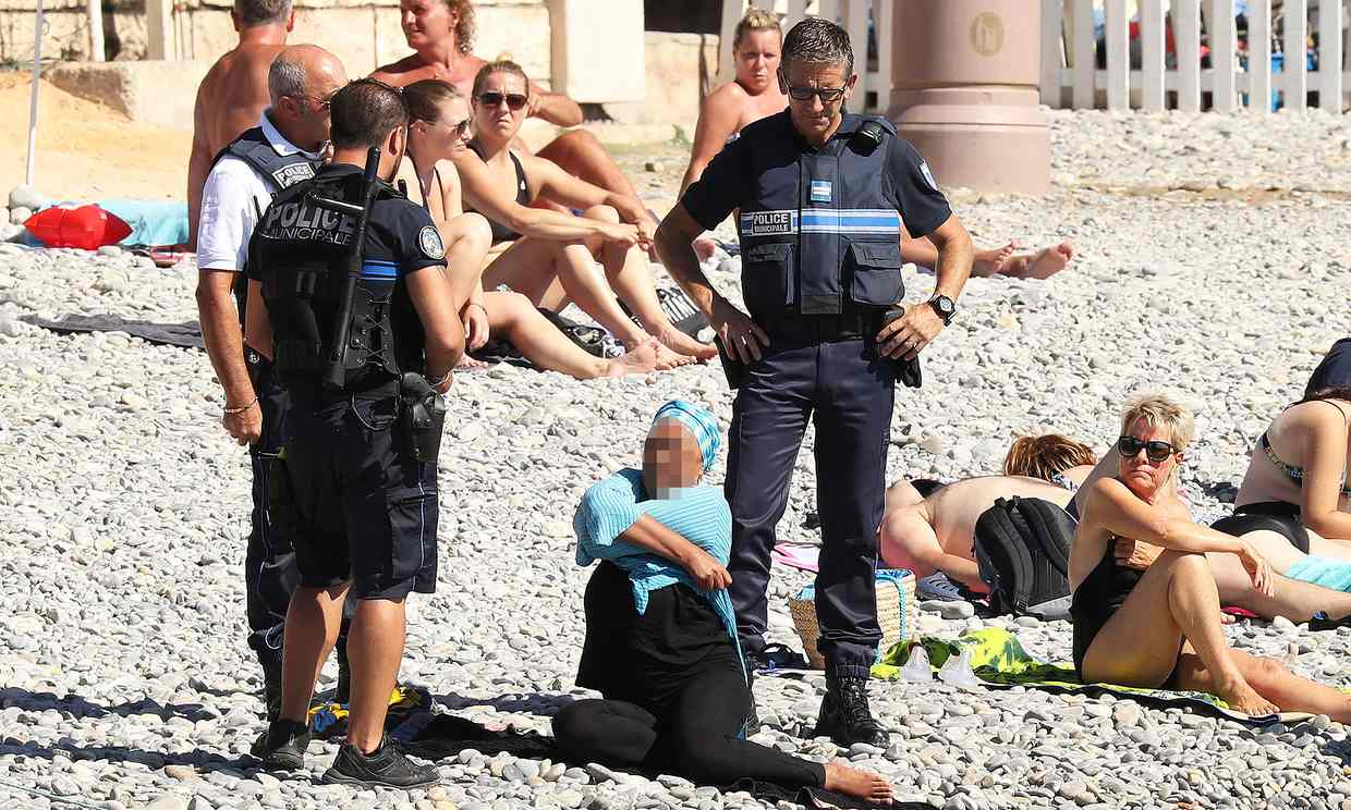 "A woman is allegedly compelled to remove an item of clothing on a Nice beach following a local ""burkini ban"""